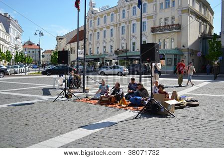 People Play Sing Indian Songs Sit On Street Carpet