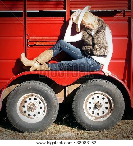 Pretty western girl On Horse Trailer