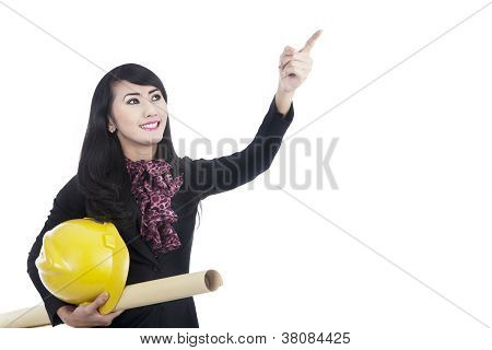 Architect Pointing At Something Isolated In White