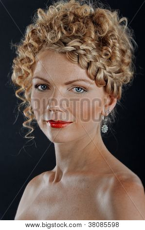 Portrait Of Beautiful Young Woman With Braid Hairdo