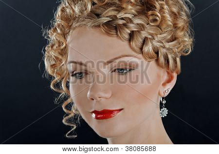 Portrait Of Beautiful Young Woman With Hairdo