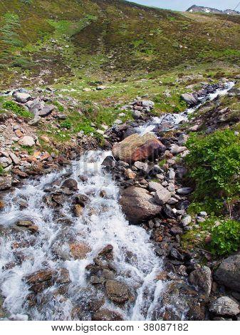 Glacier Water River In Switzerland Alps During Summer