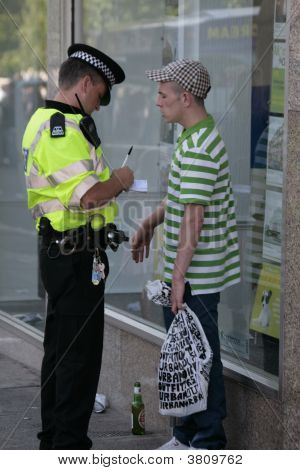 Football Fan Questioned By Policeman