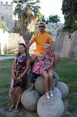 picture of cannonball  - Family is posing on a cannonballs in castle of Rhodes Greece - JPG