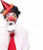 picture of clown face  - Humorous Birthday Clown Making Invitation To Guests Through Party Hat Over White Background - JPG