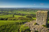 stock photo of west village  - Brent Knoll hill on the Somerset Levels in Somerset - JPG