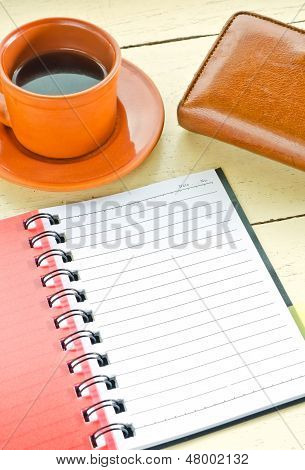 Notebook With Leather Wallet  And Cup Of Coffee