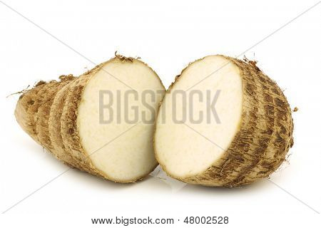 cut fresh taro root  (colocasia) on a white background