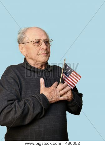 Senior Man With American Flag Vertical