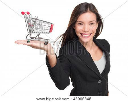 Shopping cart - business woman shopper. Woman showing holding mini shopping cart. Happy shopping or consumer loan concept with young female professional isolated on white background.