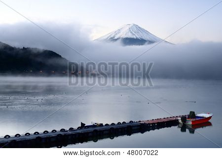 Mt. Fuji peaks from the clouds over Kawaguchi Lake in Japan.