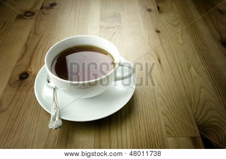 Cup of tea on wooden background, vintage style