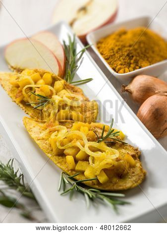 escalope with apple onions and curry, selective focus