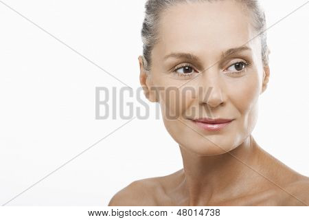 Closeup of happy middle aged woman looking away isolated on white background