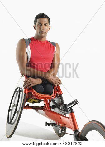 Portrait of a paraplegic cycler against white background