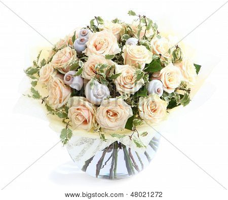 Flower Arrangement With Cream Roses And Seashells, A Transparent Glass Vase. Isolated On White Backg