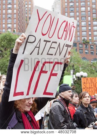 NEW YORK-MAY 25: At the March Against Monsanto in Union Square a protestor holds a sign that says 'You Can't Patent Life' on May 25, 2013 in Manhattan. There were global demonstrations against GMO's.