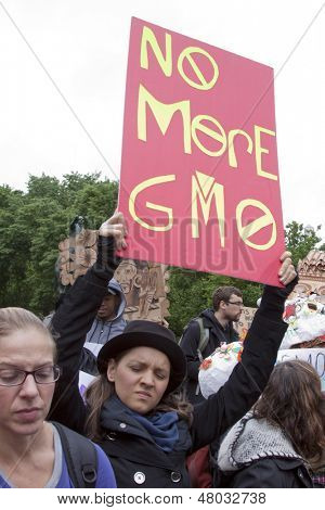 NEW YORK-MAY 25: At the March Against Monsanto in Union Square a protestor holds a sign that says 'No More GMO' on May 25, 2013 in Manhattan. The rally was part of a global movement against GMO's.