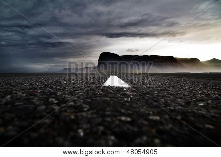ring road Iceland dramatic Icelandic landscape dark clouds white roadmarks and fog covered mountains overcast sky beautiful travel destination mysterious mood ringroad is your tourism guide to explore
