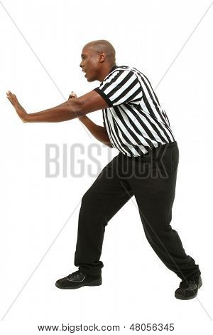 Attractive fit black man in referee uniform facing side and yelling.