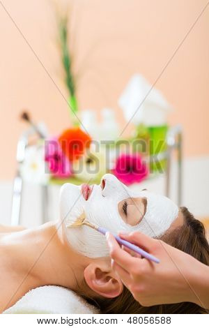 Wellness - woman receiving nurturing facial mask in spa for moist and clean skin