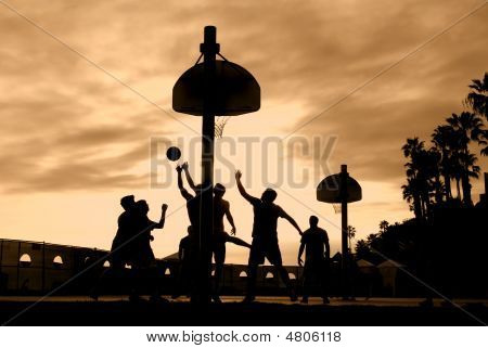Basketball Players At Sunset