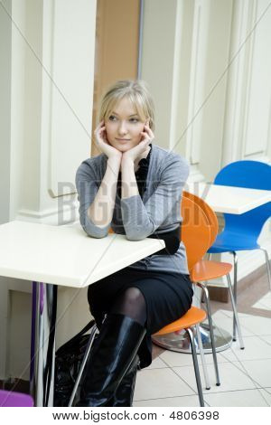 Young Attractive Blond Woman Sitting At Table In Cafe In State Department Store. Moscow