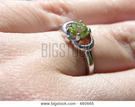 Peridot Ring On Finger Closeup