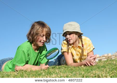 Children Playing With Magnifying Glass