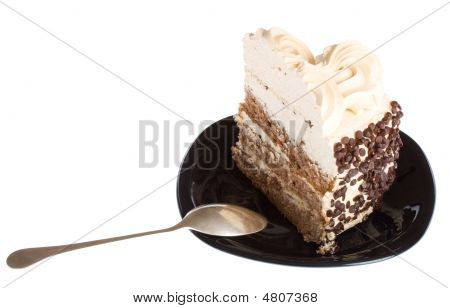 Piece Of Cake And Spoon On Black Plate