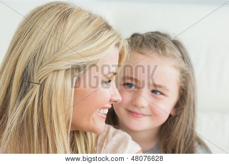 Laughing mother and daughter looking at each other