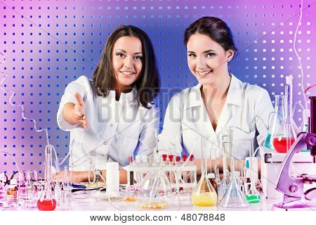 Laboratory staff, demonstrating a willingness to cooperate. Laboratory equipment.