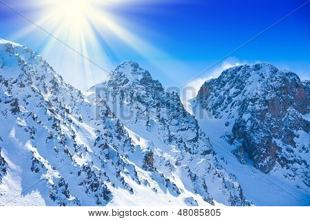 Snow On High Mountain Peaks
