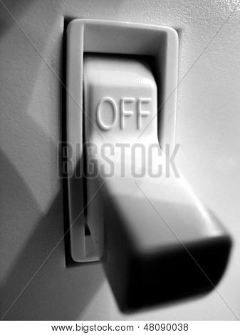 Light switch on wall inside a home in off position