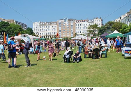 ST.LEONARDS-ON-SEA, ENGLAND - JULY 13: People take part in the St.Leonards Festival in Warrior Square Gardens on July 13, 2013 at St.Leonards-on-Sea, Sussex. The annual event was first held in 2006.