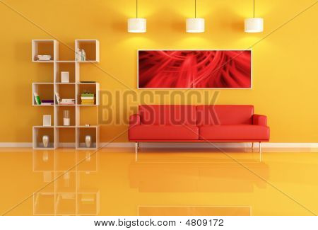 Living Room With Bookcase And Red Leather Sofa