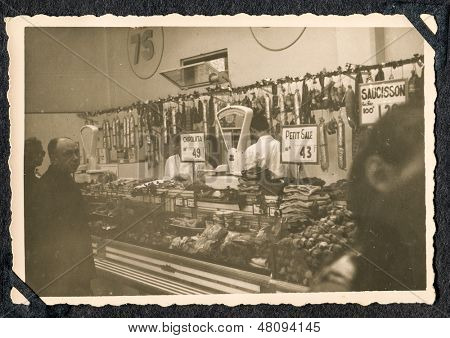 MOROCCO, CIRCA FORTIES - vintage photo of people buying in butcher shop, Morocco, circa forties