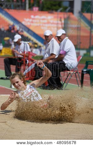 DONETSK, UKRAINE - JULY 13: Natalia Chacinska, Poland, fight for her bronze medal in long jump during World Youth Championships in Donetsk, Ukraine on July 13, 2013