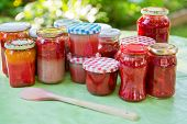 stock photo of jar jelly  - Homemade strawberry gooseberry and apricot jam in different jars - JPG