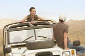 image of four-wheel drive  - Young couple in stationary four - JPG