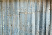 stock photo of red roof tile  - Close up grunge Grunge Corrugated Zinc Sheet wall - JPG