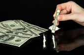 stock photo of methadone  - Cocaine drugs lines and female hand holding rolled dollar banknote - JPG