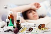 foto of high fever  - Adult woman patient with high temperature lying down bed for cold and flu illness relief - JPG