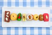 stock photo of laddu  - Colorful Indian sweets in the plate - JPG