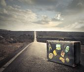 image of old suitcase  - vintage suitcase on a deserted road - JPG