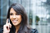 stock photo of people talking phone  - A shot of an indian businesswoman talking on the phone outdoor - JPG