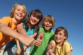 stock photo of tween  - happy group of smiling kids or children with thumbs up - JPG