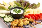 picture of endive  - Asian food with chicken skewers sauce tomatoes cucumber pineapples endives and salad - JPG