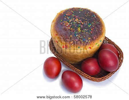 Red Easter Eggs And Easter Bread In A Basket On A White Background