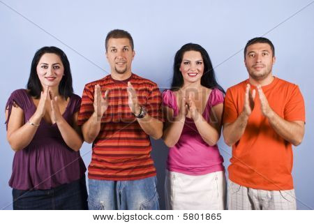 Happy Group Clappingg Hands And Smiling